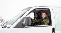 Man smiling in a van